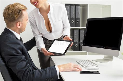 Secretary Showing Blank Screen Tablet To Her Boss Stock Photo  Image Of People, Breasts 72593798