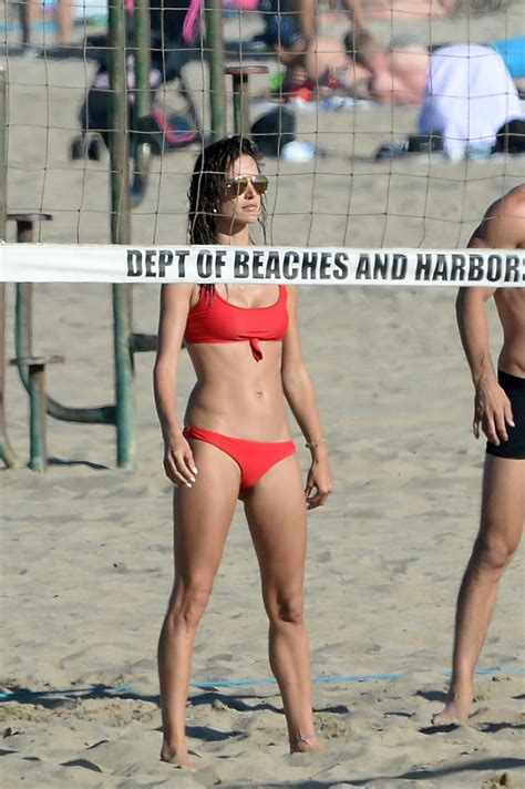 alessandra ambrosio slips into a red bikini while playing ...