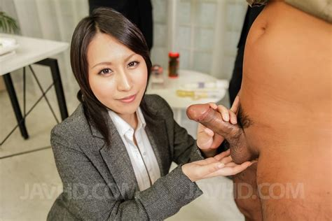 Watch porn pictures from video Yuuna Hoshisaki in office suit gets cum in palms after handjob ...
