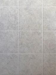 """Penny tiles have a retro vibe, but they can be used in ways that minimize the look, such as on a shower floor or as kitchen backsplash tile. DPI™ Earth Stones 9"""" x 6"""" Whiteford Brick Hardboard Wall Panel 
