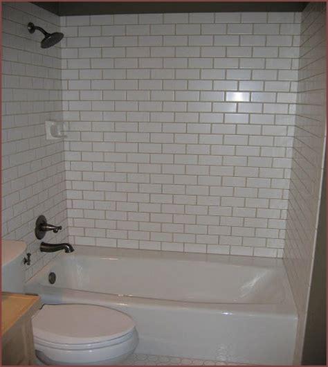 white tile bathtub surround light gray grout