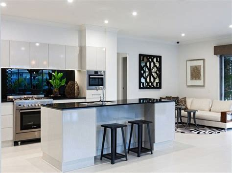 white kitchen with black benchtop