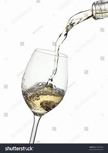 White Wine Pouring Into A Glass From A Bottle Stock Photo ...
