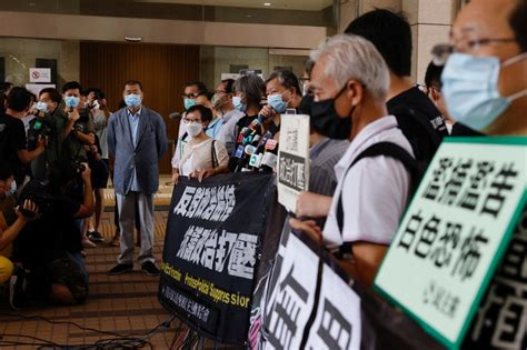 Two dozen Hong Kong activists appear in court over banned ...
