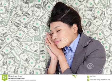 business woman sleeping  money bed stock images image