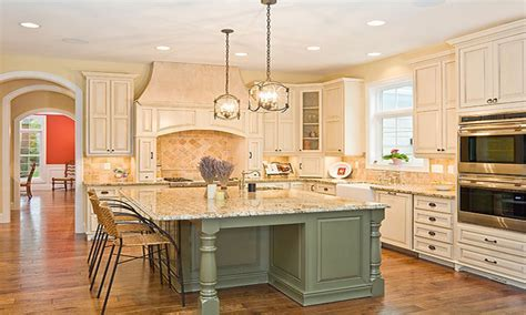 Kitchens with white cabinets and gray island, sage green