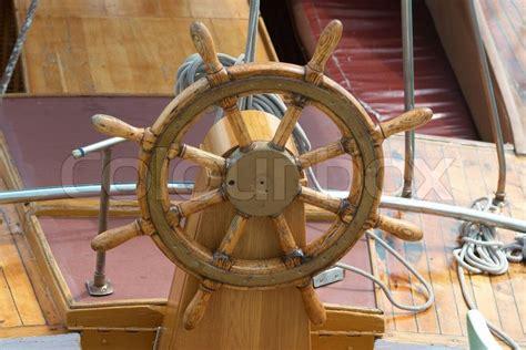 wooden steering wheel   boat stock photo