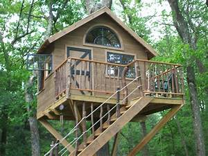 Pictures of tree houses and play houses from around the for Tree house plans