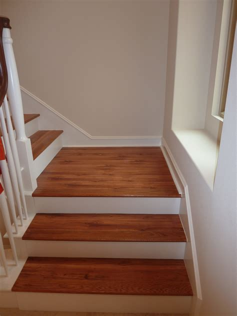 laminate that looks like tile brown color vinyl wood plank flooring on stairs with wall