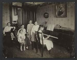 Family Around a Piano - Community Service Society Photographs