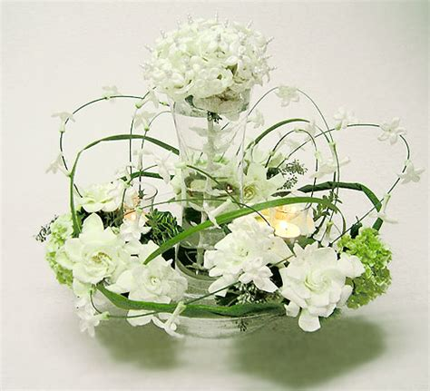 flower arrangement flowers stephanotis and gardenia centerpiece with central cluster