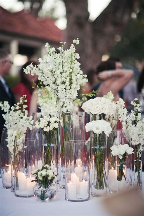vases   heights   entry table flowers