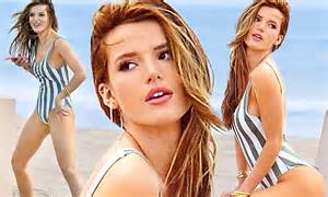 Bella Thorne looks ready for summer in striped bathing ...