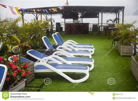 lounge chairs on deck of luxury cruise ship stock photo