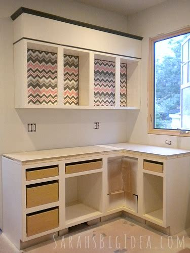 dressing up kitchen cabinets dress up your cabinets with these easy diy fabric inserts 6966