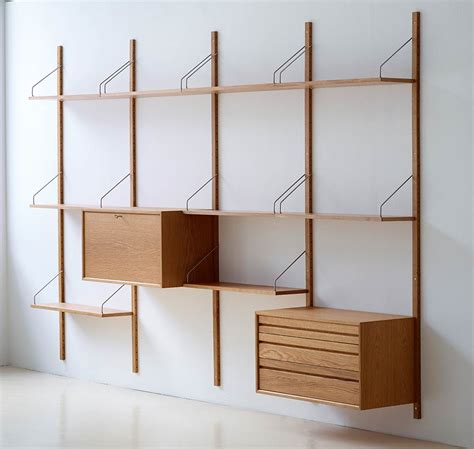 brass clothing rack royal system shelving designed by poul cadovius in 1948