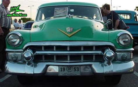 Chrome Front Grill Of A Turquoise 1953 Cadillac