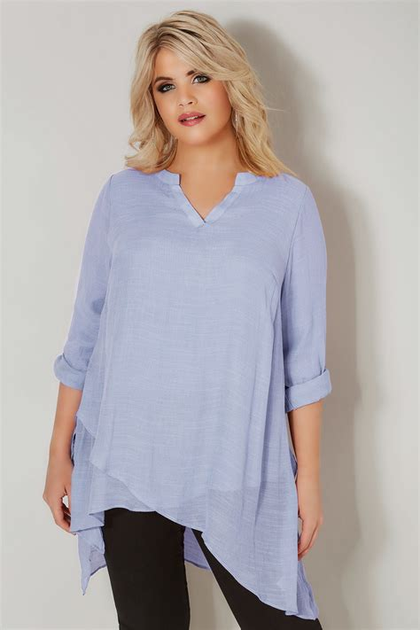 Aqilla Blouse Light Blue light blue layered blouse with notch neck dipped hem
