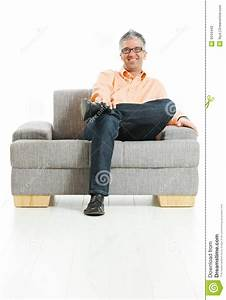 Happy Man Sitting On Couch Stock Photography - Image: 9344442