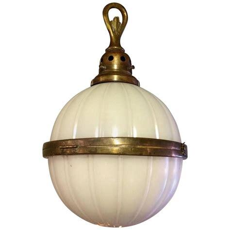 brass globe pendant light industrial ribbed milk glass and brass library globe