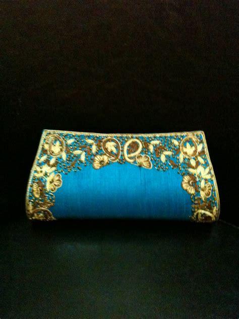deeyaras blue embroidered clutch