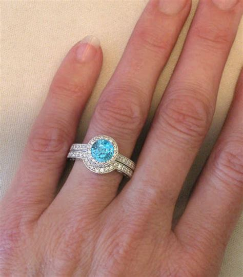 Round Blue Zircon Wedding Ring In 14k White Gold (gr1069. Class Watches. Mikimoto Pearl Pendant. Hamsa Pendant. Expandable Bangle Charm Bracelets. Bird Pendant. Floral Earrings. 3 Carat Engagement Rings. Simple Gold Bangle Bracelet