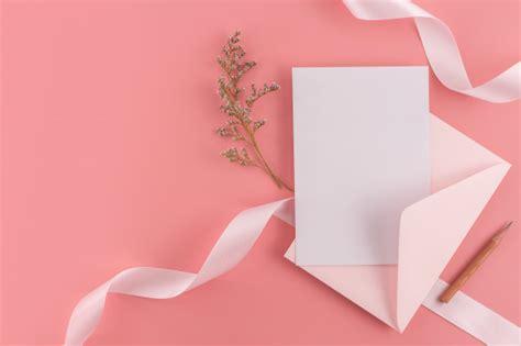 A wedding concept wedding invitation card on pink