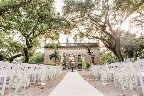 wedding ceremony florals and decor with white orchids and