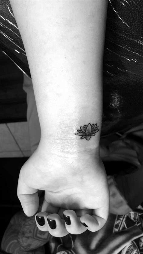 Shaded lotus flower wrist tattoo | Tattoos | Wrist tattoos, Flower wrist tattoos, Tattoos