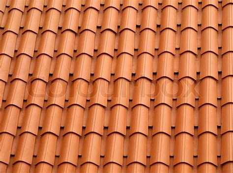 traditional orange clay roofing tiles stock photo