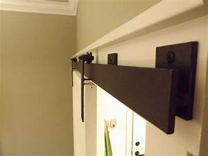 Barn door track system home decorating ideas for Barn style door track system