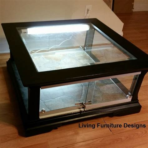Bearded dragons are referred to as sun worshipers so it's very important to give them a bright basking area. Refinishing a coffee table to hold a snake or reptile. This looks like a lot of work, but ...