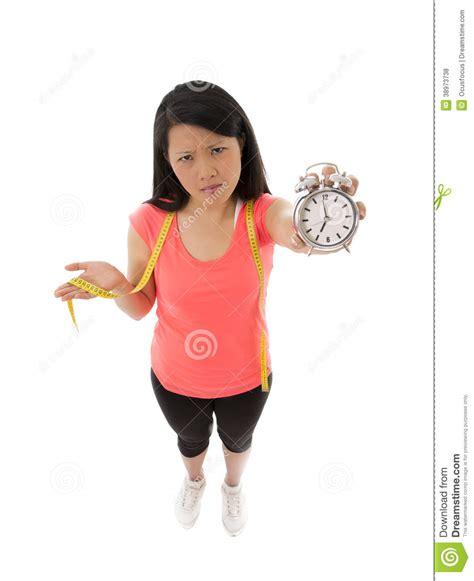 asian woman worried  starting  diet stock photo