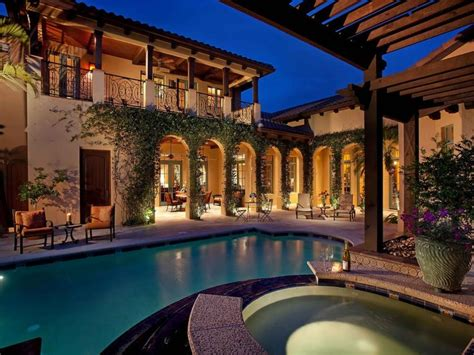 Spanish Style Home with Courtyard Pool Mediterranean Style