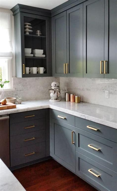 dark gray cabinets  brass hardware kitchen cabinet