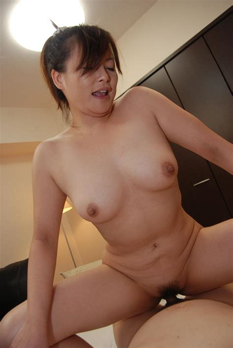 Japanese chick Chisako Nimura takes off her panties and gets her hairy pussy filled with dick