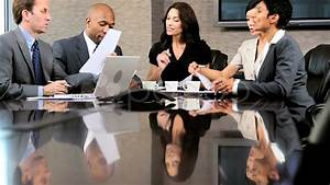 Multi Ethnic Business Group In Boardroom Meeting Stock