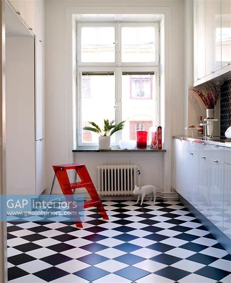 gap interiors modern white kitchen with checkered black and white vinyl flooring image no