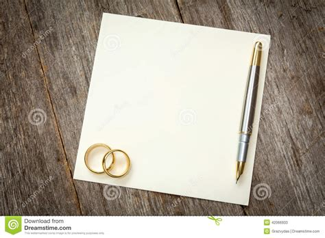 empty card  golden rings stock photo image