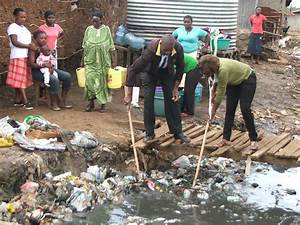 People Cleaning The Environment