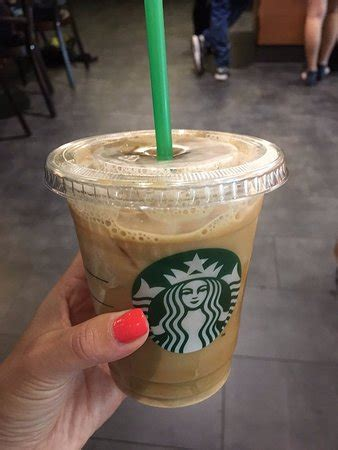 An iced vanilla latte from the coffee shop shouldn't put you into debt. Tall Iced Coffee Vanilla Cream - Picture of Starbucks, Lausanne - Tripadvisor