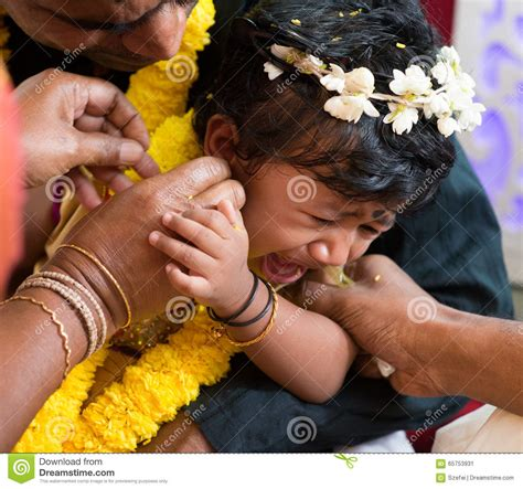 traditional indian family ear piercing ceremony stock