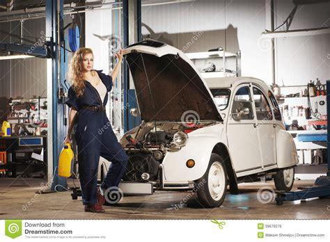 Frau In Garage by Repairing A Retro Car In A Garage Stock Photo