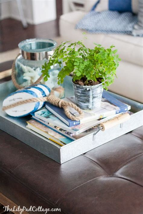 A coffee table book is a hardcover book that is intended to sit on a coffee table or similar surface in an area where guests sit and are entertained, thus inspiring conversation or alleviating boredom. How to Style a Coffee Table - 6 Ways to a Beautiful Design Tidbits&Twine