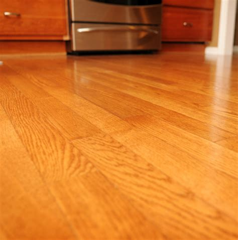 care of hardwood floors in kitchen laminate flooring vs tile in kitchen 9379