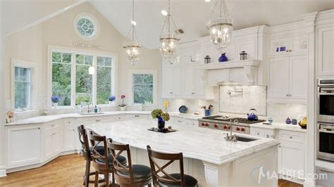 Kitchen With An Island - classic white quartzite popular stone kitchen design