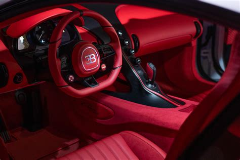 The first chiron pur sport was recently delivered by bugatti to a customer in the united states, featuring a quartz white upper exterior with a grey carbon pur sport split and an exposed grey carbon lower. First Bugatti Chiron Pur Sport Delivered in the USA - 1 of ...