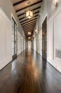 Slanted Ceiling Lighting by Long Hallway With Lanterns Transitional Entrance Foyer