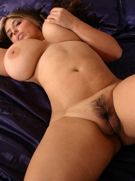 Chubby Babe With Huge Breasts Lying On The Bed
