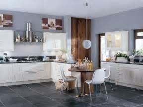 Ivory cabinets, black countertops, gray floor, slate blue